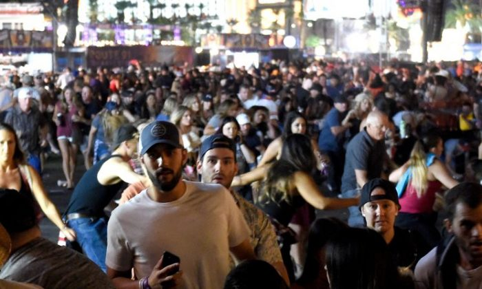 People flee the Route 91 Harvest country music festival grounds after a active shooter was reported in Las Vegas on Oct. 1, 2017 . (David Becker/Getty Images)