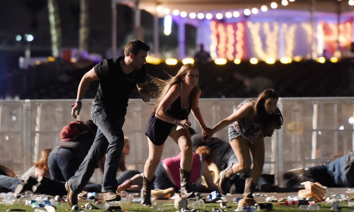 People run from the Route 91 Harvest country music festival after gun fire was hears on Oct. 1, 2017 in Las Vegas, Nevada. (David Becker/Getty Images)