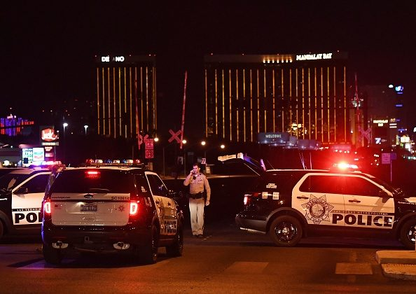 Police form a perimeter around the road leading to the Mandalay Hotel after a gunman killed at least 58 people and wounded more than 500 others when he opened fire on a country music concert in Las Vegas on Oct. 1, 2017. (MARK RALSTON/AFP/Getty Images)