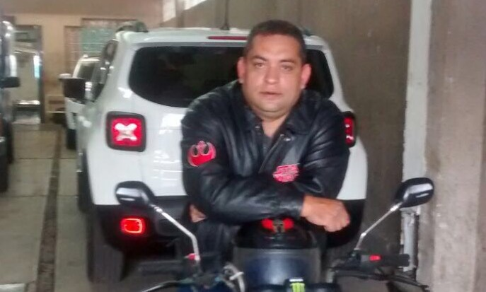 Jaime Uribe Rosales, 44, sits atop his motorcycle in the parking garage of 168 Bolivar in Mexico City. The building collapsed during the earthquake on Sept. 19, trapping Rosales after he evacuated 25 from the building and returned in an effort to find his wife, who rode out the collapse by clinging to an antenna on the building's roof. (Courtesy of the family)