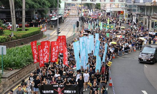 Heeding China's Call, Hong Kong Tightens Grip on Dissent