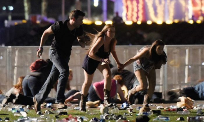 People run from the Route 91 Harvest country music festival after apparent gun fire was hear on Oct. 1, 2017 in Las Vegas. (David Becker/Getty Images)