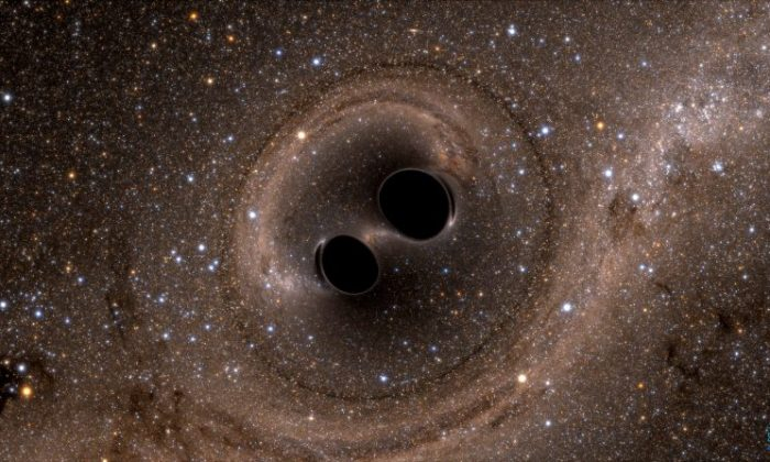 The collision of two black holes—an event detected for the first time ever by the Laser Interferometer Gravitational-Wave Observatory, or LIGO—is seen in this still from a computer simulation. (Courtesy of SXS Project/California Institute of Technology/Handout via REUTERS)