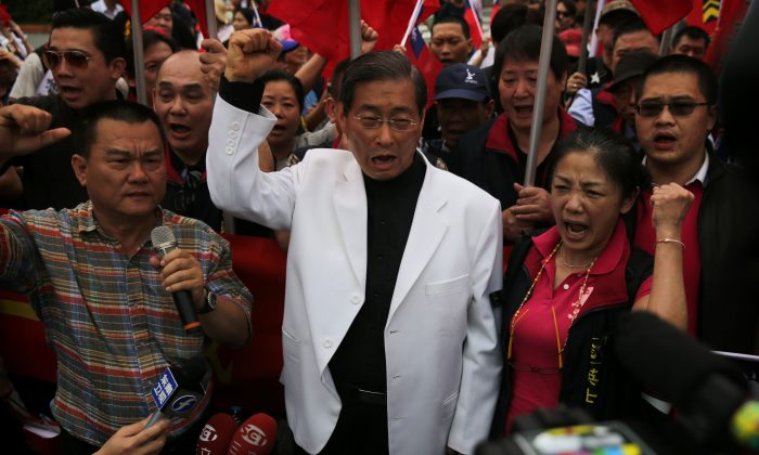 """File photo from 2016 showing Chang An-lo, also known as the """"White Wolf,"""" leader of the China Unification Promotion Party and a well-known gang boss in Taiwan. Members of Chang's party are alleged to have assaulted students following a Sept. 24 protest. (Isaac Lawrence/AFP/Getty Images)"""
