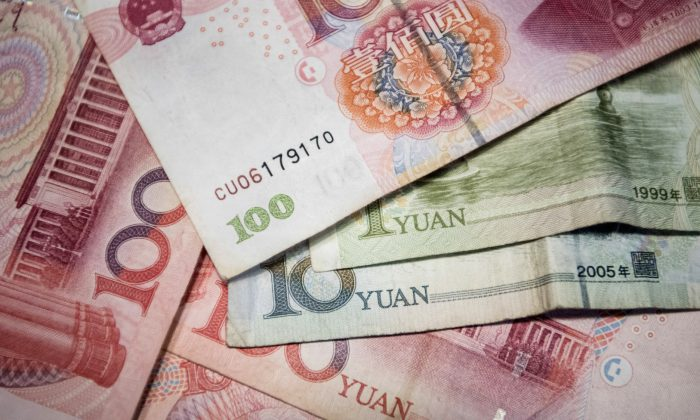 Chinese yuan notes in Beijing, taken on Sept. 29, 2016. (Fred Dufour/AFP/Getty Images)