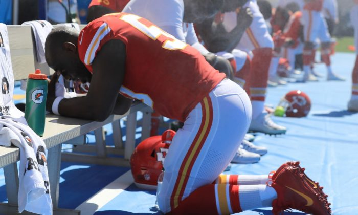 Justin Houston of the Kansas City Chiefs is seen taking a knee during the National Anthem before a game. (Sean M. Haffey/Getty Images)