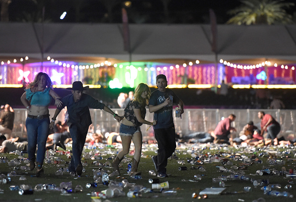 People run from the Route 91 Harvest country music festival after gun fire was heard in Las Vegas on Oct. 1, 2017. (David Becker/Getty Images)