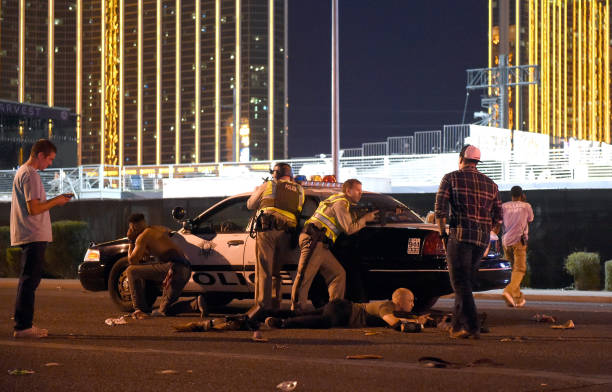 Las Vegas police stand guard along the streets outside the Route 91 Harvest country music festival grounds after an active shooter was reported in Las Vegas on Oct. 1, 2017. (David Becker/Getty Images)