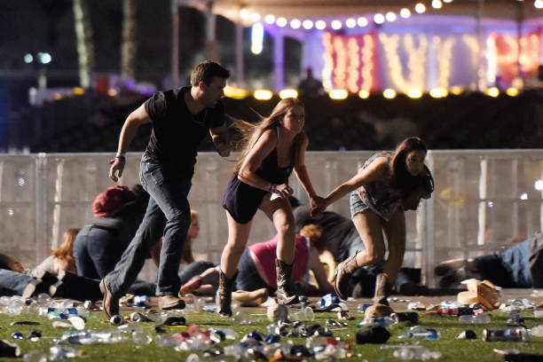 People run from the Route 91 Harvest country music festival after apparent gun fire was heard in Las Vegas on Oct. 1, 2017. (Photo by David Becker/Getty Images)