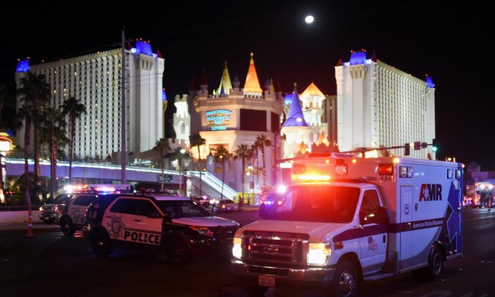 An ambulance leaves the intersection of Las Vegas Boulevard and Tropicana Ave. after a mass shooting at a country music festival nearby in Las Vegas on Oct. 2, 2017. (Ethan Miller/Getty Images)