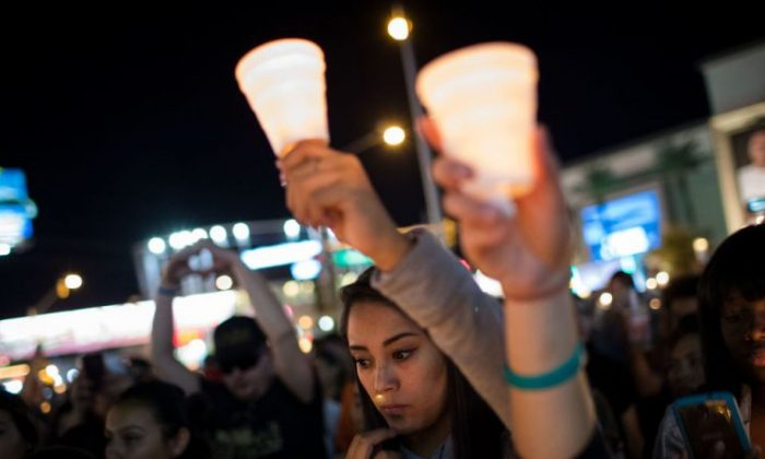 Mourners attend a candlelight vigil at the corner of Sahara Avenue and Las Vegas Boulevard for the victims of Sunday night's mass shooting, Oct. 2, 2017, in Las Vegas. (Drew Angerer/Getty Images)