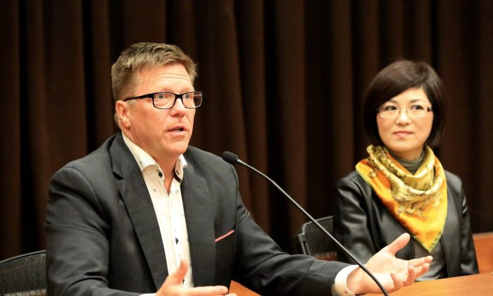 """Michel Juneau-Katsuya, a former CSIS senior manager, and filmmaker Doris Liu take part in a panel discussion following the screening of Liu's documentary """"In the Name of Confucius"""" during Ottawa's One World Film Festival on Sept. 30, 2017. (Jonathan Ren/The Epoch Times)"""