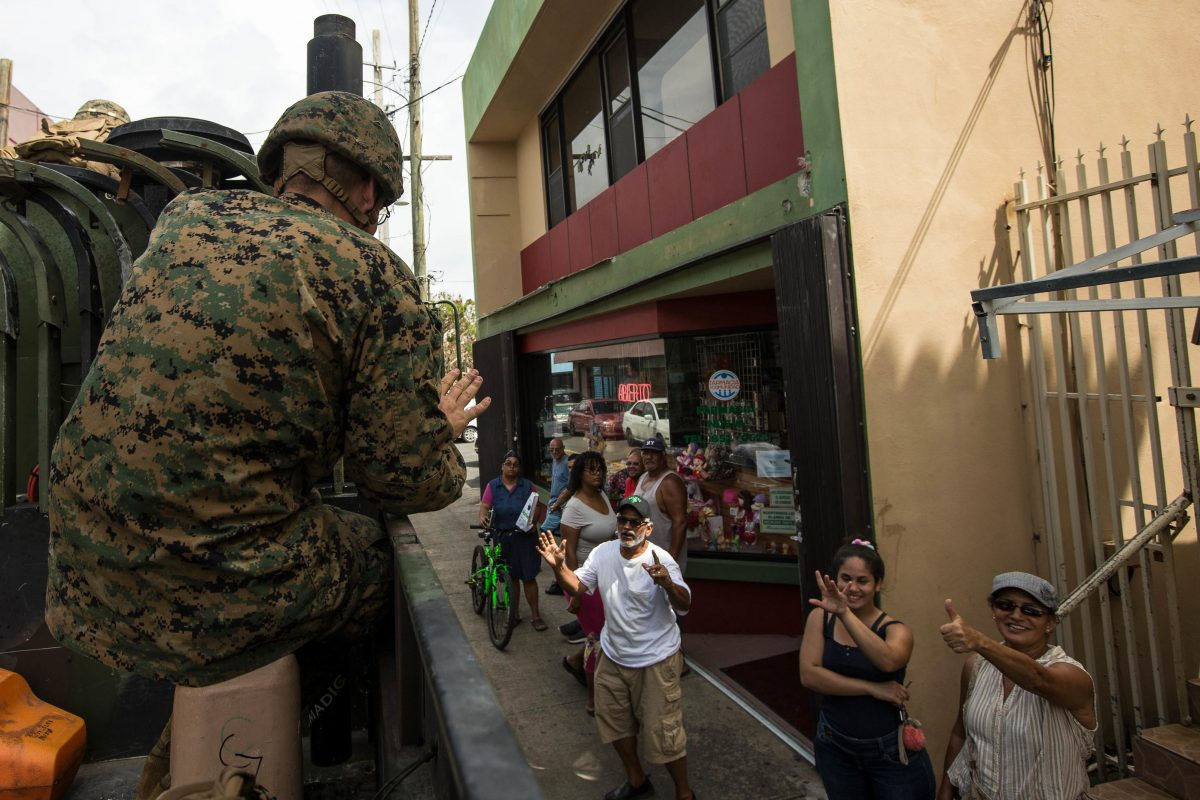 170927-M-CA957-0127 HUMACAO, Puerto Rico (Sept. 27, 2017) U.S. Marine Corps 1st Lt. Charles V. McCole, an officer with the Air Traffic Control Mobile Team of the 26th Marine Expeditionary Unit (26th MEU), waves to local residents during departure from Humacao Hospital after conducting a medical and operational needs assessment as part of Hurricane Maria relief efforts in Humacao, Puerto Rico, Sept. 27, 2017. The Department of Defense is supporting the Federal Emergency Management Agency, the lead federal agency, in helping those affected by Hurricane Maria to minimize suffering and is one component of the overall whole-of-government response effort. (U.S. Marine Corps photo by Lance Cpl. Tojyea G. Matally/Released)