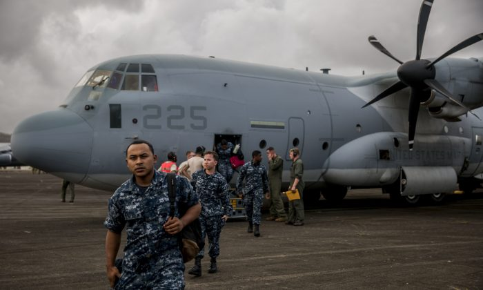 U.S. Marines and Sailors exit a KC-130J Super Hercules aircraft at the Jose Aponte de la Torre Airport to provide aid and hurricane relief in Puerto Rico on Sept. 27, 2017.  (U.S. Marine Corps photo by Lance Cpl. Cody J. Ohira/Released)