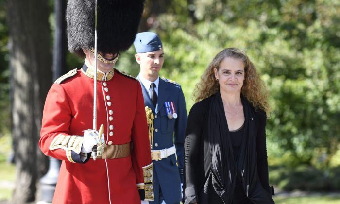 Gov. Gen. Julie Payette inspects the Guard of Honour during a ceremony at Rideau Hall in Ottawa after being installed as Canada's 29th Governor General, Oct. 2, 2017. (The Canadian Press/Justin Tan)