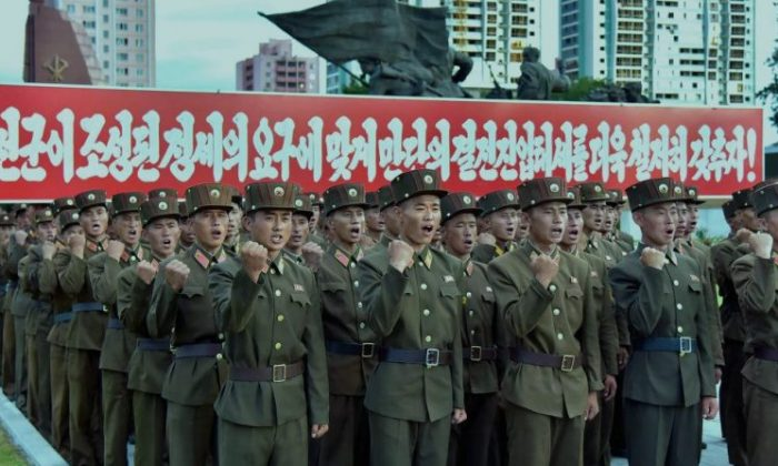 This picture taken on August 10, 2017 and released by North Korea's official Korean Central News Agency (KCNA) on August 11, 2017 shows service personnel of the Ministry of People's Armed Forces at a rally in support of North Korea's stance against the US, at the fatherland liberation war victory monument and education square in Pyongyang. (STR/AFP/Getty Images)