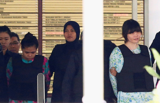 Vietnamese Doan Thi Huong and Indonesian Siti Aisyah who are on trial for the killing of Kim Jong Nam, the estranged half-brother of North Korea's leader, are escorted as they leave the Shah Alam High Court on the outskirts of Kuala Lumpur, Malaysia. (Reuters/Lai Seng Sin)