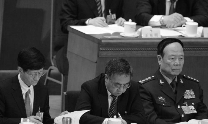 Former vice chairman of the Central Military Commission, Guo Boxiong, at far right, on March 5, 2013. (Goh Chai Hin/AFP/Getty Images)