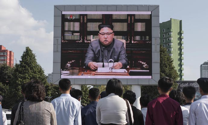 North Koreans watch a statement delivered by dictator Kim Jong Un on a television screen outside of the railway station in Pyongyang on Sept. 22. A top CIA analyst says Kim is not irrational and must face a strong threat from the United States in order to be restrained. (Ed Jones/AFP/Getty Images)