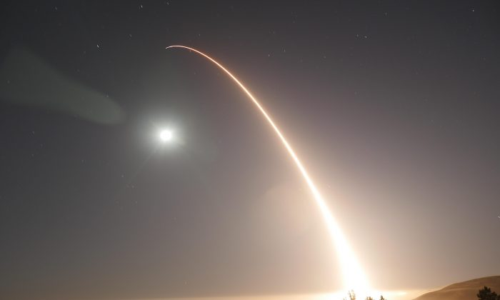 An unarmed Minuteman III intercontinental ballistic missile launches during an operational test at Vandenberg Air Force Base, Calif., on May 3. Defense Department officials cited the need for consistent Congressional support for modernizing and maintaining effective nuclear deterrent systems. (Air Force photo by 2nd Lt. William Collette)
