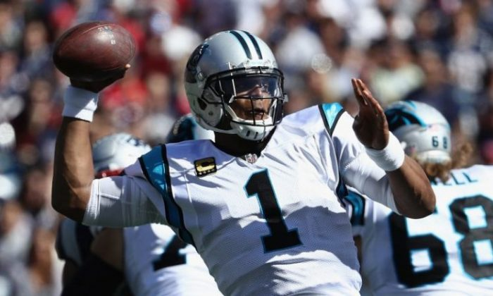 Cam Newton No. 1 of the Carolina Panthers throws a pass during the first half against the New England Patriots at Gillette Stadium on Oct. 1, 2017, in Foxboro, Mass.  (Maddie Meyer/Getty Images)