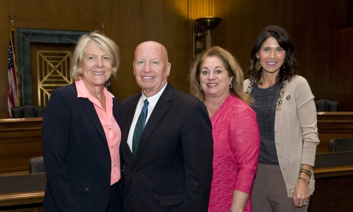 (L-R) Women Impacting Public Policy (WIPP) President Jane Campbell, House Ways and Means Committee Chairman Kevin Brady, WIPP board member Rebecca Boenigk and Rep. Kristi Noem at the WIPP congressional luncheon in Washington on Oct 4, 2017. (Courtesy of WIPP)