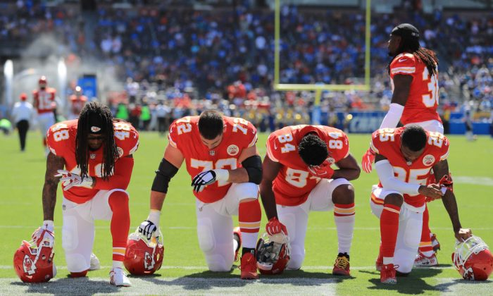 Terrance Smith No. 48, Eric Fisher No. 72, Demetrius Harris No. 84, and Cameron Erving No. 75 of the Kansas City Chiefs are seen taking a knee before the game against the Los Angeles Chargers at the StubHub Center on Sept. 24, 2017, in Carson, Calif. (Sean M. Haffey/Getty Images)