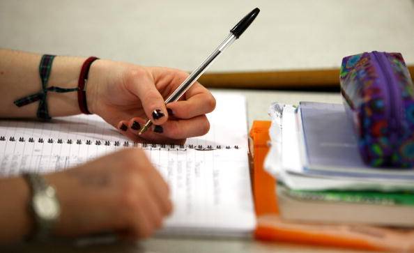 Pupils at Williamwood High School attend a biology class. (Photo by Jeff J Mitchell/Getty Images)