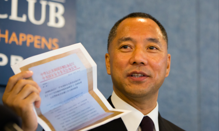 Chinese billionaire Guo Wengui holds a photocopy of a document allegedly from the Chinese Communist Party's Central National Security Council requesting the Ministry of State Security to send more spies to the United States, at a press conference at the National Press Club in Washington on Oct. 5, 2017. (Samira Bouaou/The Epoch Times)