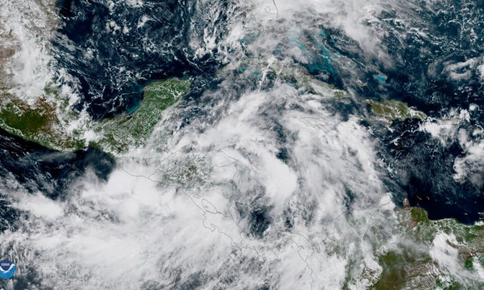 Tropical Storm Nate gains strength in the Caribbean Sea as it moves toward the U.S. Gulf Coast in this NOAA Satellite image taken Oct. 6, 2017. (NOAA Satellites/Handout via REUTERS)
