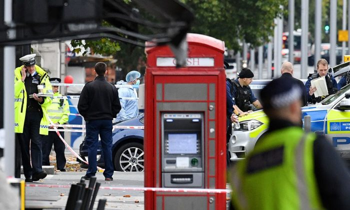 Police officers at the scene on Exhibition Road after a car mounted the pavement and collided with pedestrians outside the Natural History Museum on Oct. 7, 2017, in London. (Leon Neal/Getty Images)