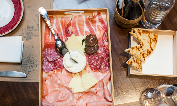 A platter of cheeses and cured meats in Ravenna, Emilia-Romagna. (Channaly Philipp/The Epoch Times)