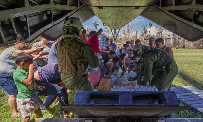 Sailors deliver supplies from an MH-53E Sea Dragon helicopter during relief efforts in Puerto Rico, Oct. 5, 2017. (Navy photo by Petty Officer 3rd Class Michael Molina)