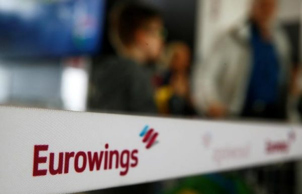 People line up behind a barrier tape of Lufthansa's budget airlines Eurowings during a 24-hour strike over pay and working conditions at Cologne-Bonn airport, Germany on Oct. 27, 2016. (Reuters/Wolfgang Rattay)