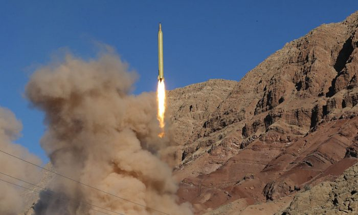 A long-range Qadr ballistic missile is launched in the Alborz mountain range in northern Iran on March 9, 2016. (Mahmood Hosseini/AFP/Getty Images)