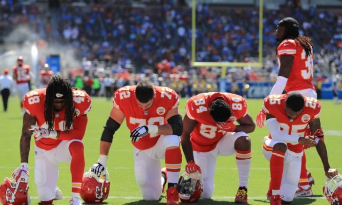 Terrance Smith #48, Eric Fisher #72, Demetrius Harris #84, and Cameron Erving #75 of the Kansas City Chiefs are seen taking a knee before the game against the Los Angeles Chargers at the StubHub Center in Carson, Calif. on Sept. 24, 2017.  (Sean M. Haffey/Getty Images)