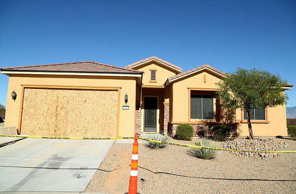 Police tape lines the driveway in front of the house in the Sun City Mesquite community where Las Vegas gunman Stephen Paddock lived in Mesquite, Nev., on Oct. 2, 2017.