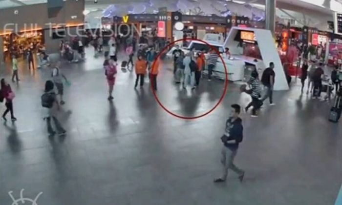 A still image from a CCTV footage appears to show a man purported to be Kim Jong Nam (circled in red) talking to airport staff, after being accosted by a woman in a white shirt, at Kuala Lumpur International Airport in Malaysia on Feb. 13, 2017. (FUJITV/via Reuters TV)