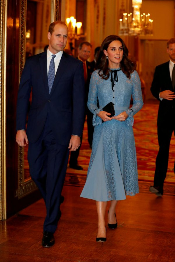 Britain's Prince William, Duke of Cambridge, Catherine Duchess of Cambridge and Prince Harry celebrate World Mental Health Day at Buckingham Palace in London, Britain on Oct. 10, 2017. (Reuters/ Heathcliff O'Malley/Pool)