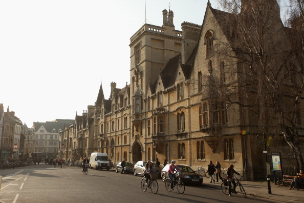 People cycle along Broad Street past Balliol College in Oxford on March 22, 2012. (Oli Scarff/Getty Images)