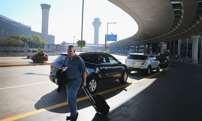 A passenger at O'Hare International Airport in Chicago, Ill. (Scott Olson/Getty Images)