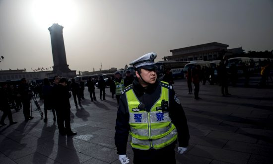 Mother of Detained Canadian Citizen Tries to Sue Beijing Police for Torture, Imprisonment
