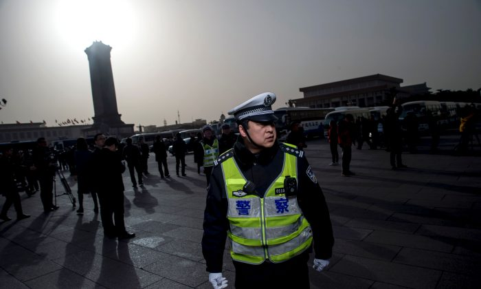 A policeman stands at the Great Hall of the People in Beijing on March 5, 2016.  (Fred Dufour/AFP/Getty Images)