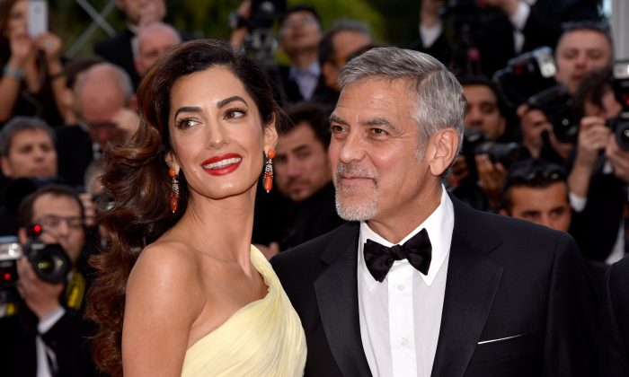 """Actor George Clooney and his wife Amal Clooney attend the """"Money Monster"""" premiere during the 69th annual Cannes Film Festival at the Palais des Festivals in Cannes, France, on May 12, 2016.  (Clemens Bilan/Getty Images)"""