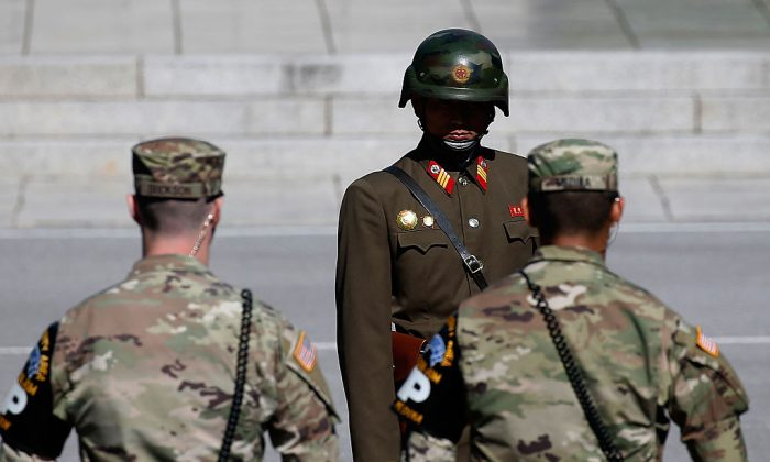 A North Korean soldier (back) stands guard at the Military Demarcation Line in the border village of Panmunjom between South and North Korea in Panmunjom, South Korea on Oct. 9, 2016. (Jeon Heon-Kyun-Pool/Getty Images)
