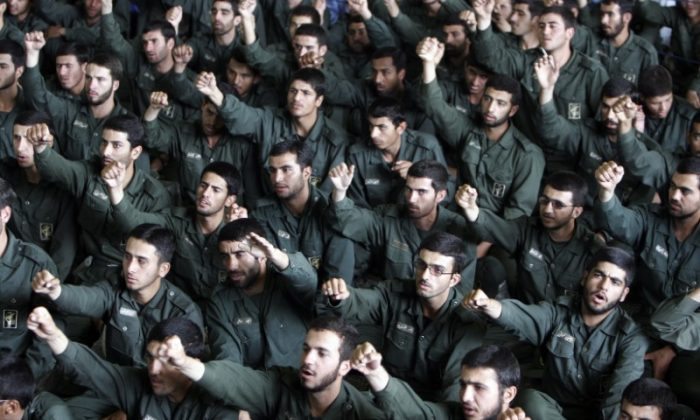 Iranian revolutionary guard corps chant slogans during Friday prayers in Tehran on May 26, 2006. A new report claims the Revolutionary Guards has been driving a nuclear weapons program while blocking IAEA inspections. (Reuters/Raheb Homavandi)