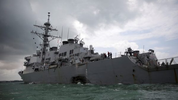 The U.S. Navy guided-missile destroyer USS John S. McCain is seen after a collision, in Singapore waters on Aug. 21, 2017. (Reuters/Ahmad Masood/File Photo)