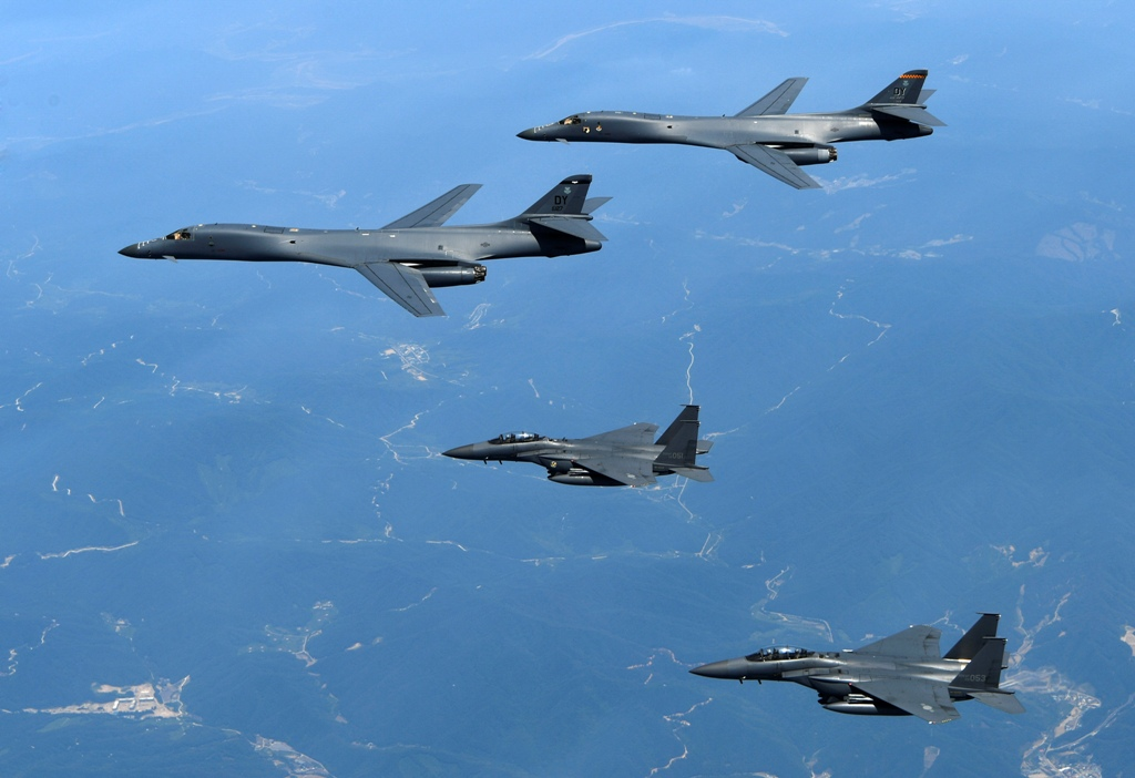 In this June 20, 2017 file photo provided by South Korean Defense Ministry, U.S. Air Force B-1B bombers, top, and second from top, and South Korean fighter jets F-15K fly over the Korean Peninsula, South Korea. (South Korean Defense Ministry via AP, File)