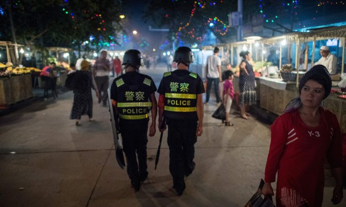 Police patrol a night market near the Id Kah Mosque in Kashgar, Xinjiang, on June 25, 2017. (Johannes Eisele/AFP/Getty Images)