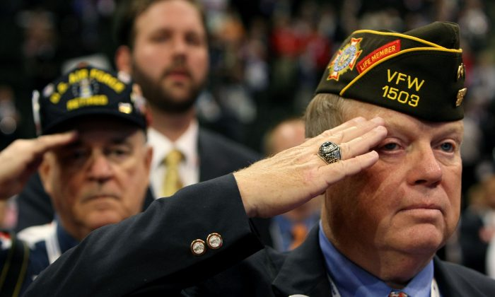 Members of the VFW salute on day three of the Republican National Convention (RNC) at the Xcel Energy Center in St. Paul, Minnesota, in this Sept. 3, 2008 file photo. (Justin Sullivan/Getty Images)